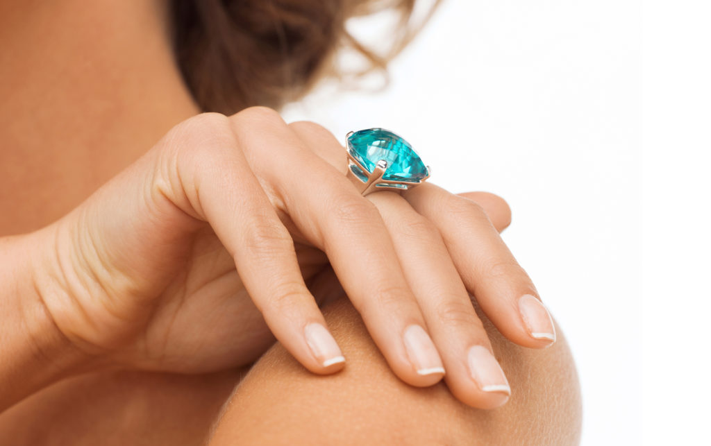 Woman with a blue cocktail ring